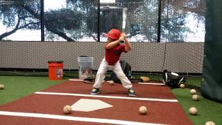 My 4 year old hitting in the batting cages.