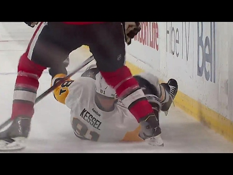 Phaneuf gives Kessel a rough ride along the boards