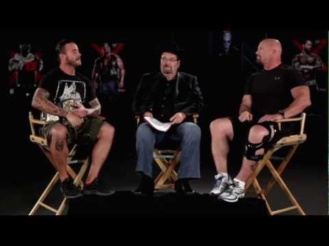 Tension boils over when CM Punk and Stone Cold Steve Austin talk WWE '13 (Official)