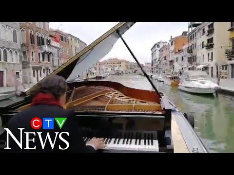 Italian pianist Paolo Zanarella performs while sailing down Venice canal