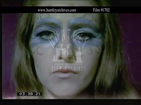 Close ups of women's faces and make up.  Archive film 91702