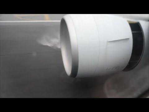 Boeing 777. GE90 Jet Engine. Reverse Thrust on Wet Runway. Hong Kong