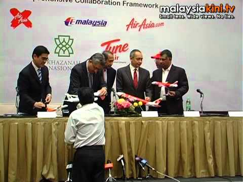 MAS-Air Asia ink restructuring deal