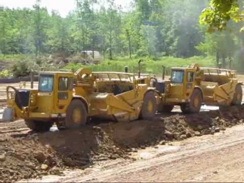 Living on the Edge -- CAT Earthmovers excavating a pond -- 7-22-11.wmv