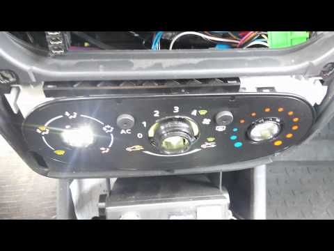 видео: Замена ламп подсветки консоли в Рено Логан