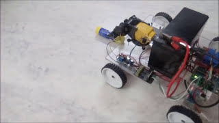 Mobile app controlled robotic vehicle with arm. made by Rupak Poddar