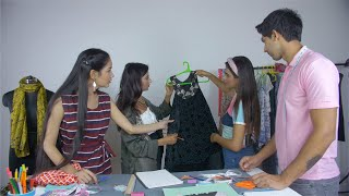 Female college teacher taking fashion studies lecture - creative education