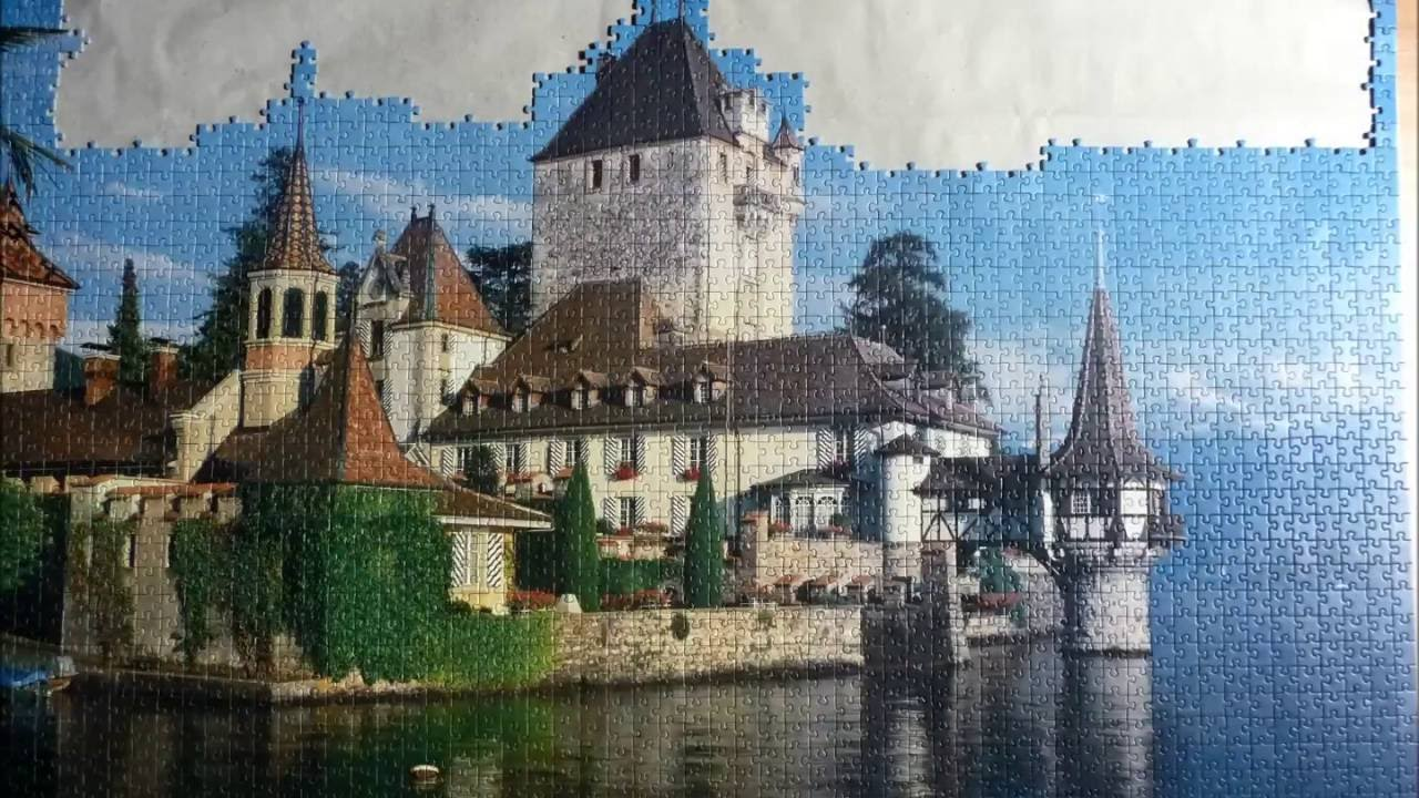 Automatic puzzle solver solving 600 blue jigsaw puzzle pieces based only on  the contour shape