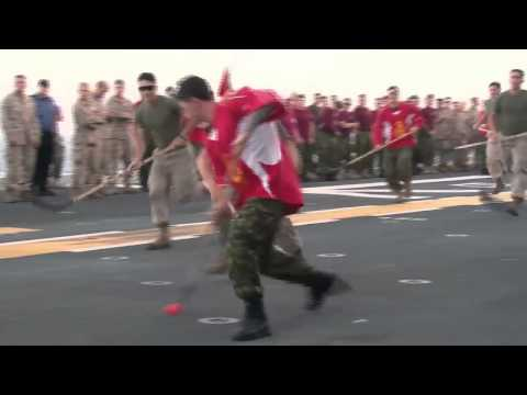 Canadian Soldiers Face Off Against U.S. Navy Sailors on USS Essex in Hockey