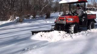 UTV Hitchworks - Kubota RTV 900 equipped with our Farmboy and Plowboy snow plowing