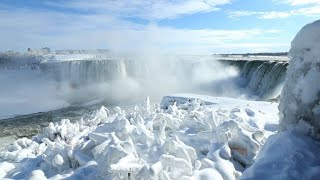 Niagara Falls partially frozen over in North American cold snap