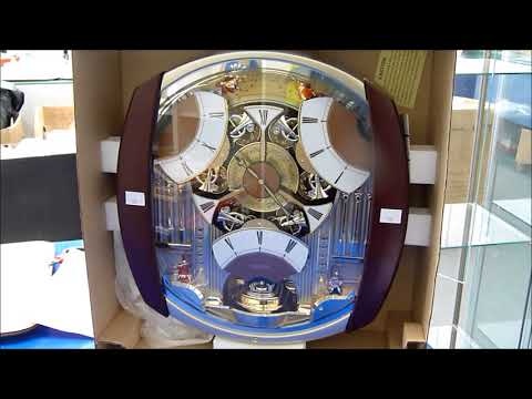 A Seiko Wall Clock with hourly chiming and clock face movement which reads 'Melodies in Motion