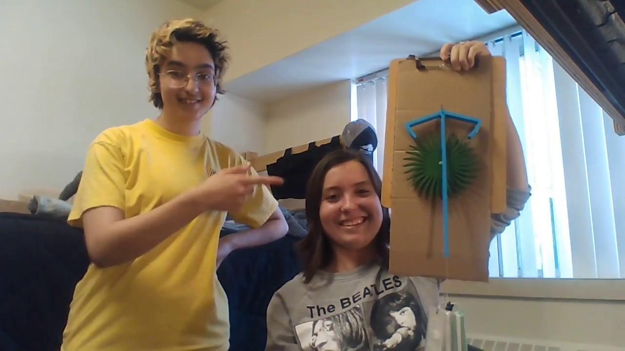 students and a pendulum clock