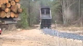 Volvo Dump Truck Spreading Slag Rock