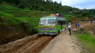 TATA Power! TATA Bus traverses a muddy dirt road in Nepal thumbnail