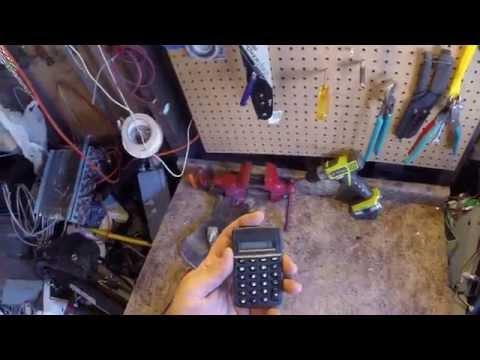 scrapping a small calculator found in the trash