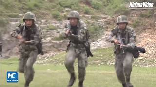 Chinese Iron army troops conduct live-fire training