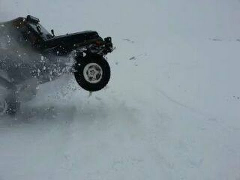 Jeep Driving In Snow Avoiding Stuck Cars