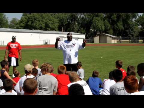 Tommie Frazier addressing youngsters at Panhandle Football Camp n Scottsbluff