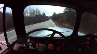 1.31.12 freightliner flc120 lowboy cat 268b ctl loading situation and hauling