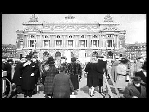 French civilians and German soldiers mingle at metro station in Paris. HD Stock Footage
