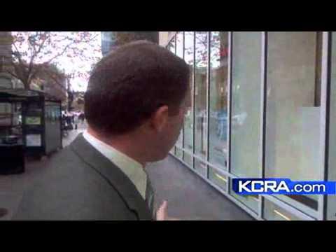 Workers Board Up Windows In Oakland