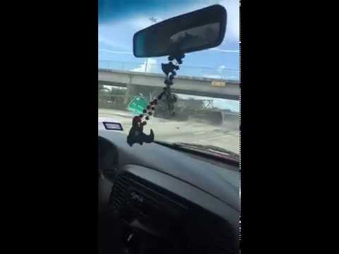 Dump truck takes out Houston freeway sign on the highway