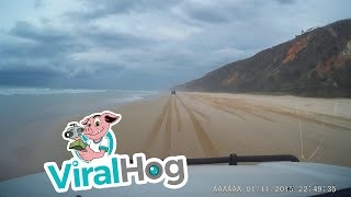 Jet Flies Over While Driving on Beach || ViralHog