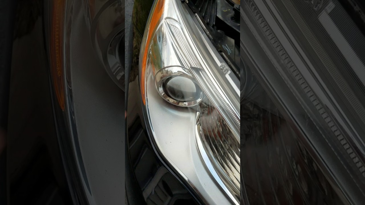 2012 chrysler 200 headlight bulb replacement
