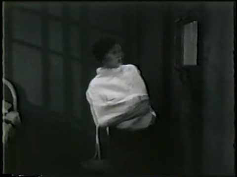 IMPATIENT MAIDEN Una Merkel in straitjacket