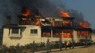 Wildfires blaze through Los Angeles area