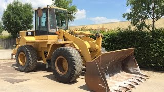 Caterpillar 938F loader working and demonstration