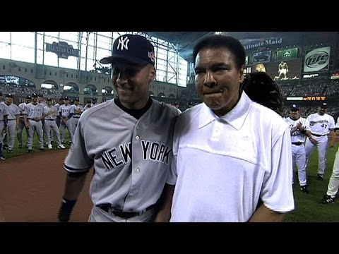 AL@NL: Muhammad Ali helps throw out the first pitch