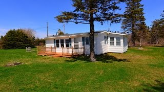 Waterfront Cottage For Sale With Extra Oceanfront Lot Included In Prince Edward Island Canada.