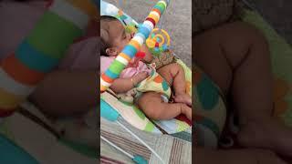 Baby rocks himself to sleep in a bouncer