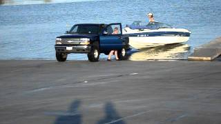 Boat falls off trailer (almost)