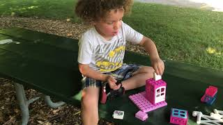 Kids Playing At The Park Building Lego Toys