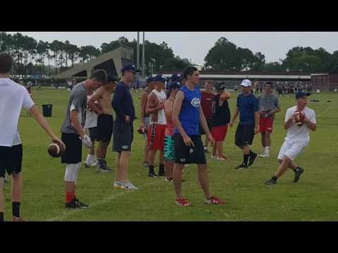 Peyton Manning and Brandon Harris coaching at Manning Passing Academy