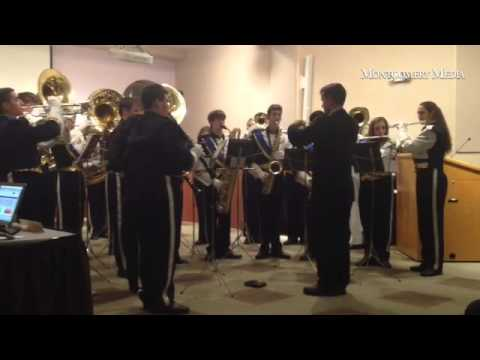 Members of the Council Rock High School South Marching Band perform at a school board meeting.