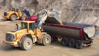 Volvo L180F Wheelloader Loading Scania And Volvo Trucks