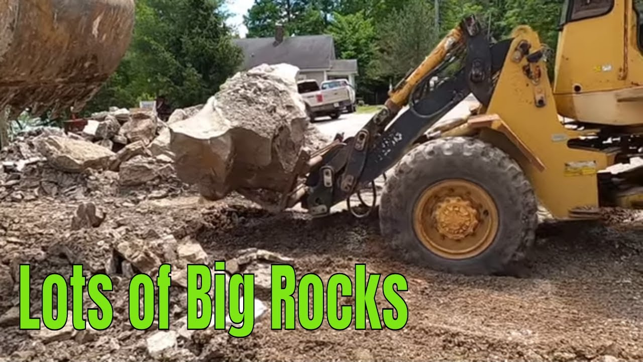 Building a retain wall using natural stone with Volvo excavator quite the puzzle #awesome