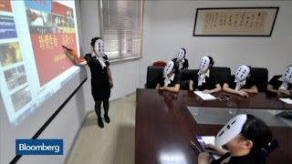 Why Are These People Wearing Masks to Work?