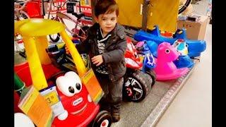Little Boy doing Shopping at ToysRus