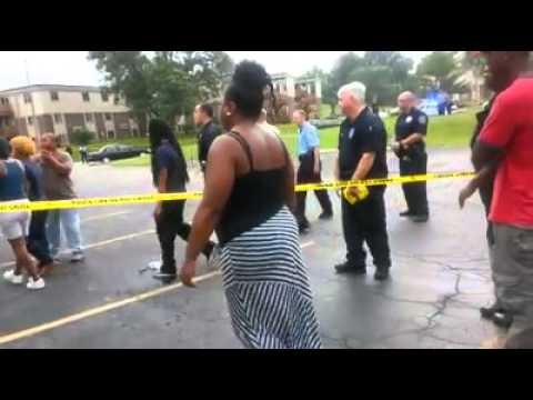 Michael Brown's mother yells at police.