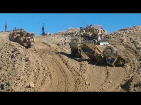 Heavy Equipment Action W/ Mountain Blasting
