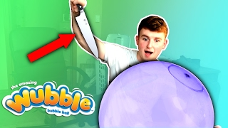 DESTROYING THE WORLDS BIGGEST WUBBLE BUBBLE BALL ( Experiment )