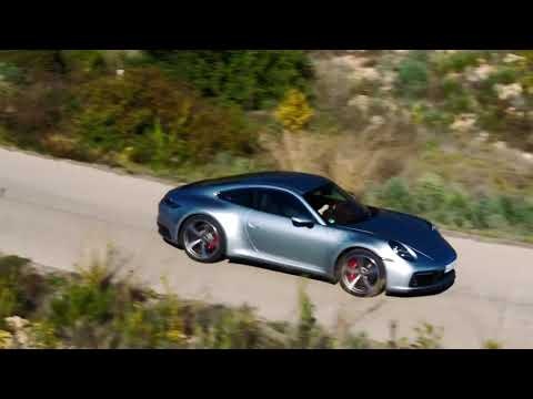 Porsche 911 Carrera S in Silver Metallic Driving in on the Country Road