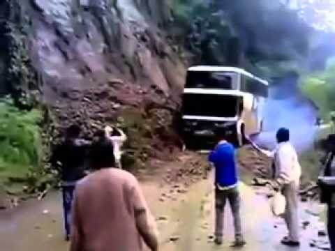 Indian bus topples due to landslide