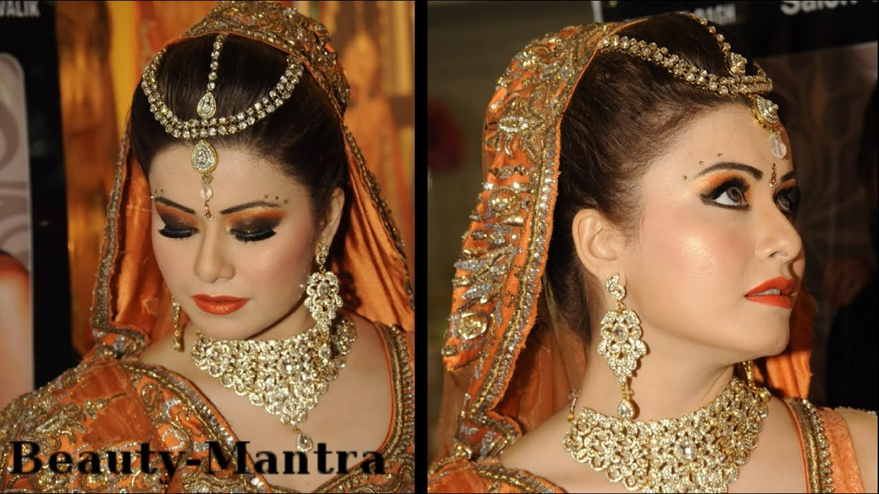 wedding makeup - black and orange smokey eyes - complete hair and