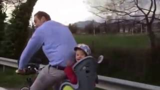 Tyson Fury having some family time riding a bike between camp sessions